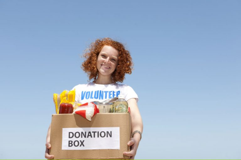 Woman holding donation box