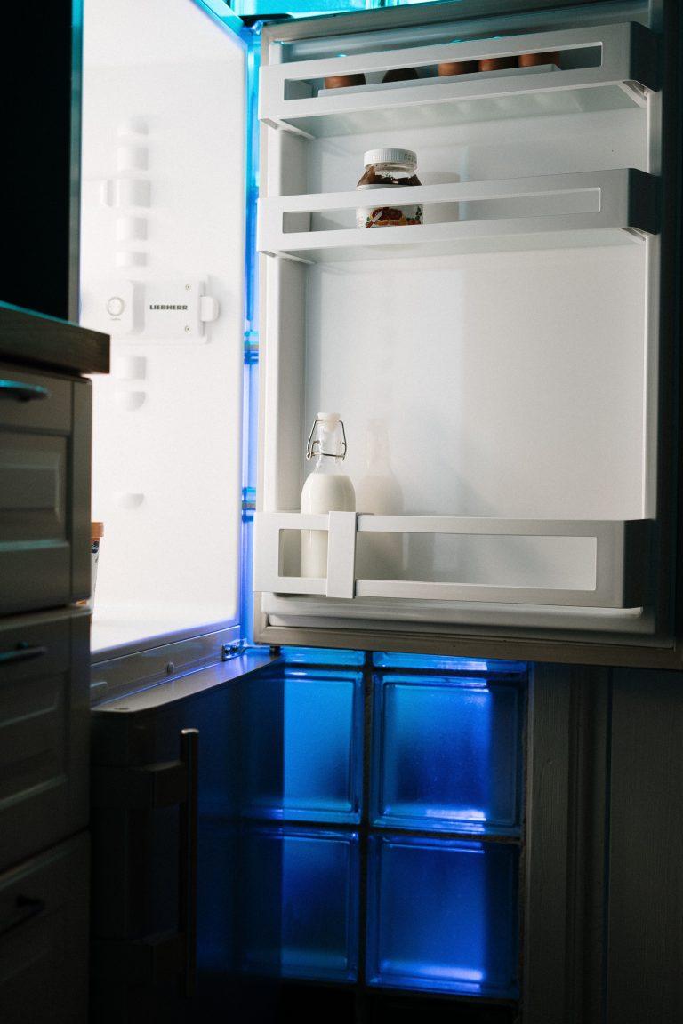 open fridge door with a few items