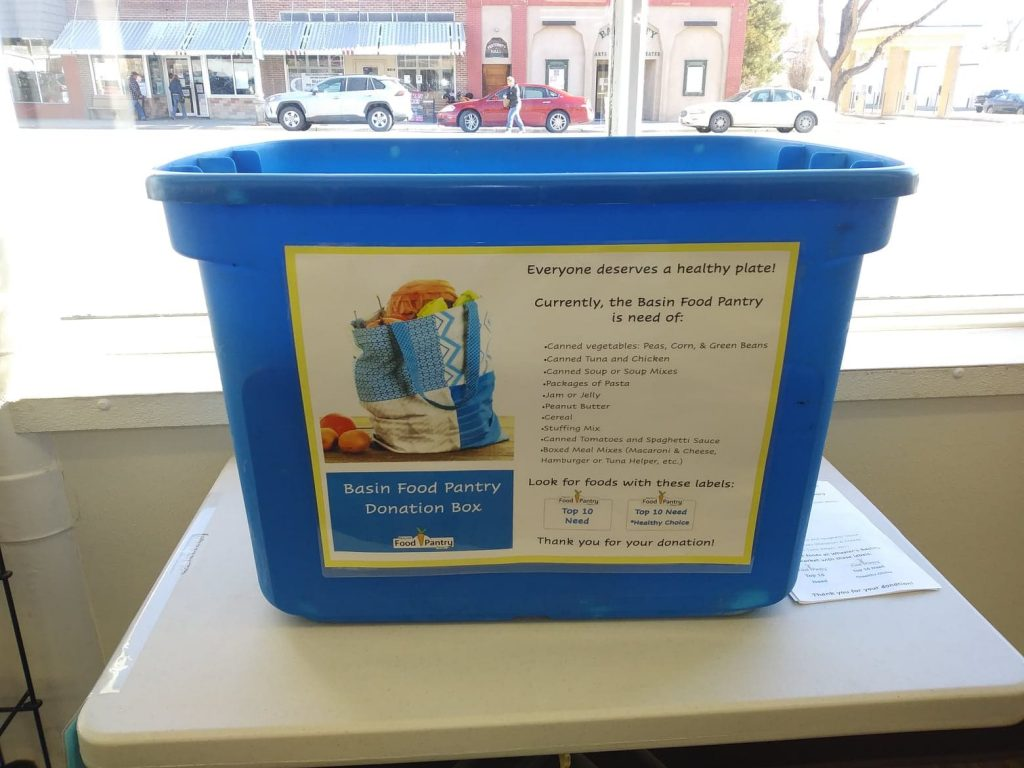 Blue plastic tub with a sign on the front