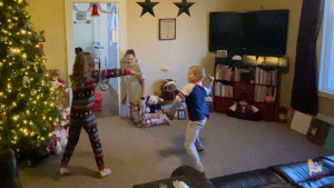 two kids throwing paper balls in house