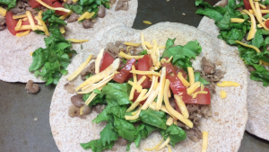 beans and toppings on baked tortillas